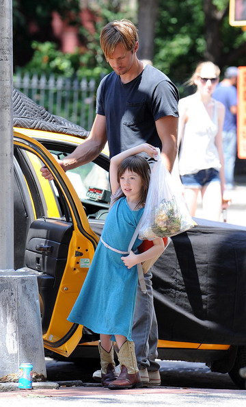 "PLAY DATE - Actor Alexander Skarsgard and his young co-star film a scene for the new dramatic movie ""What Maisie Knew"" in New York.  The two co-stars appear to have a natural chemistry as they interact with each other on set."