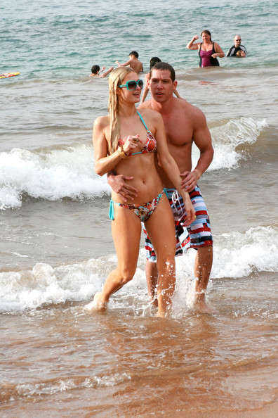 Paris Hilton and boyfriend Cy Waits frolic around in the waves on Maui beach. The couple are spending Christmas  in Hawaii with Paris's parents Kathy and Rick, her sister Nicky and Nicky's boyfriend David Katzenberg. .