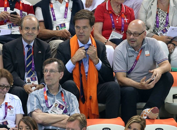 Prince Frederik of Denmark and wife Princess Mary of Denmark watch the swimming competition at the Aquatics Center of the Olympic Park