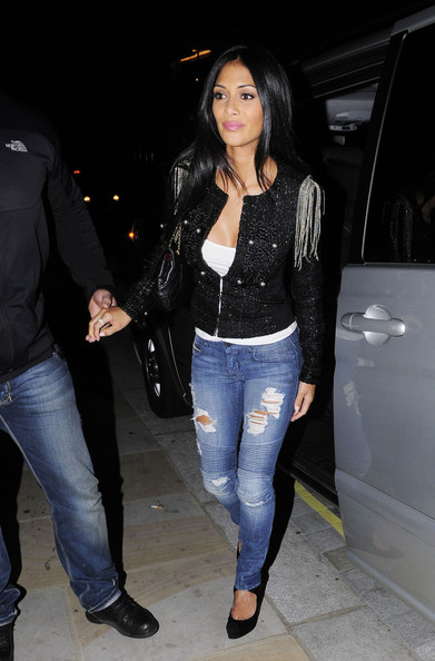 Pussycat Doll Nicole Scherzinger arrives at Nobu restuarant in London to meet fellow singer Enrique Iglesias for dinner. The pair, who met at 9.30pm, arrived in separate cars. At 11.45pm they emerged, jumping into their cars and returning to their respective hotels. Enrique currently has a single out called Heartbeat featuring Nicole.