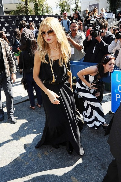 Celebrity stylist Rachel Zoe makes her way out of the tents at Mercedes Benz Fashion Week 2012 in New York City with husband Rodger Berman.