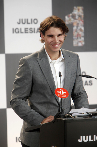 Rafael Nadal Rafael Nadal presents Spanish singer Julio Iglesias with an award for his groundbreaking record sales at Cervantes Institute in Madrid. The awards were the Latino Artist Award and the Award for Artist selling the most records in Spain.