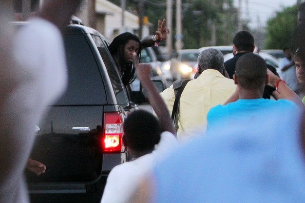 Rapper Lil Wayne, aka 'Weezy', goes shirtless as he leaves the grand ...