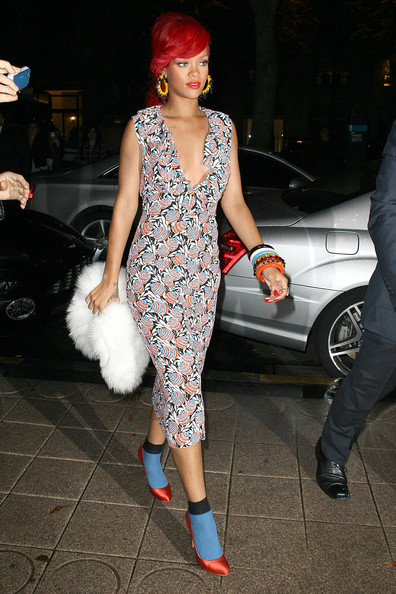 Rihanna Rihanna, wearing a low cut floral dress with red high heels and blue socks, and boyfriend Matt Kemp attend the Miu Miu Spring/Summer 2011 show during the Paris Fashion Week. The couple then went to a Parisian restaurant for a romantic dinner.