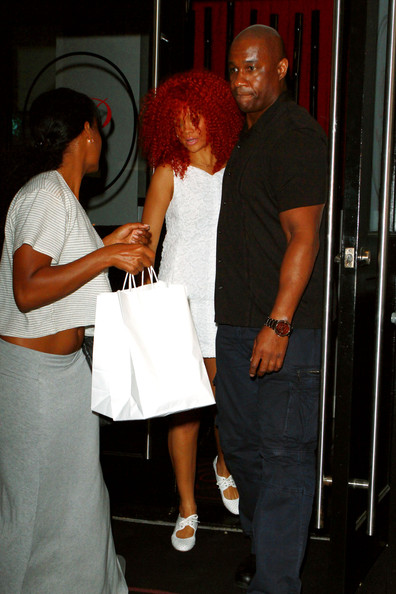 Rihanna Rihanna has dinner with a girlfriend and a bodyguard at the Philippe Chow restaurant in Los Angeles. The fire-haired Barbadian beauty was wearing a simple white summer dress and flats. Rihanna features on the cover of the April edition of the US Vogue, the 10th Annual Shape issue.