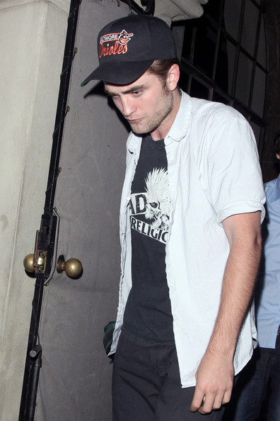 "Robert Pattinson Hollywood heartthrob Robert Pattinson celebrates his latest award with friends at Chateau Marmont. Earlier in the evening the ""Twilight"" star won ""Choice Vampire"" at the 2011 Teen Choice Awards."