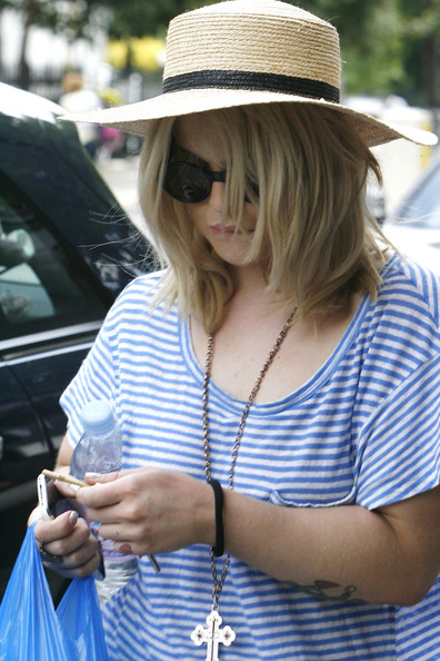 A summery Kelly Osbourne does a spot of shopping in North London.