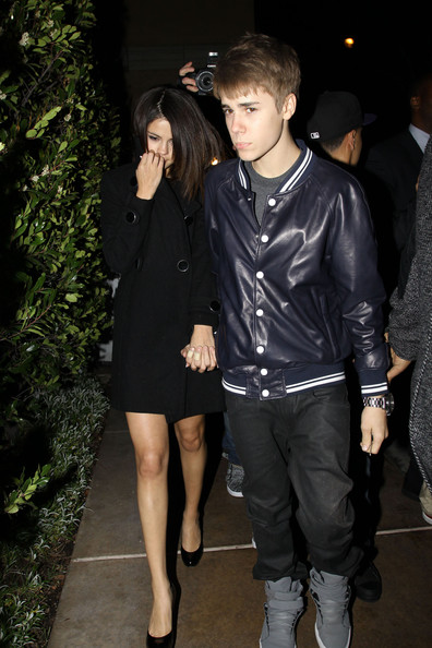 Selena Gomez Justin Bieber celebrates his 17th birthday with girlfriend Selena Gomez. As they left Maggiano's at The Grove, Bieber's lady seemed very keen to hide her face from photographers, perhaps becuase she was sporting a large red lump on her lip.