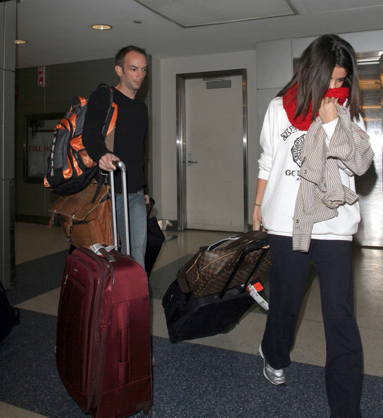 Selena Gomez Selena Gomez struggles with her luggage upon arrival at JFK Airport from Los Angeles. The 'A Year Without Rain' singer, who is currently dating teen sensation Justin Bieber, has reportedly complained that she wishes to be known for her work not her personal life.