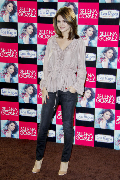 Selena Gomez Selena Gomez launches her new album in the Spanish capital Madrid. The Disney darling's latest recording is entitled A Year without Rain and is the follow-up to her successful debut, Kiss & Tell.