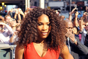 Tennis legend Serena Williams shows off her incredible physique in a form fitted red zip up dress as she makes her way into 'The Late Show With David Letterman' in New York City.