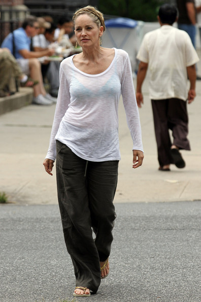 "Sharon Stone, famous for her role in ""Basic Instinct"", walks to her trailer while on break from filming the new movie "" Gods Behaving Badly"" in New York.  It is reported that Stone's 26-year-old boyfriend Chase Dreyfous visits her on set."