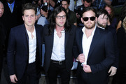 """The """"Kings of Leon"""" arrive at the """"Women of the Year"""" Glamour Awards at Berkerley Square in London. (L-R) Musicians Jared Followill, Nathan Followill and Caleb Followill."""