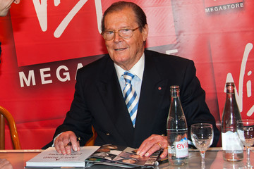 Sir Roger Moore HAPPY ANNIVERSARY 007!! 84 year old legendary actor and former James Bond star Sir Roger Moore seen at a signing for new book 'James Bond par Roger Moore' held at the Virgin Megastore in Paris