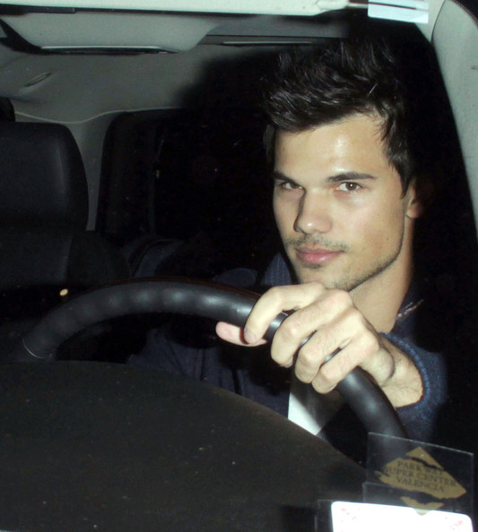 Taylor Lautner - 'Twilight' wolfboy Taylor Lautner is seen leaving the Staples centre after watching the LA Clippers basketball game with his High School sweetheart and Clippers cheerleader Sara Hicks in Los Angeles