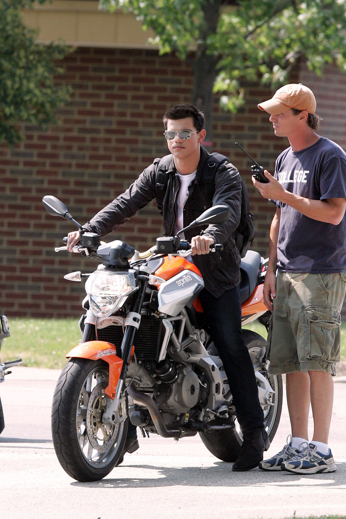 taylor lautner in taylor lautner drives a motorcycle while