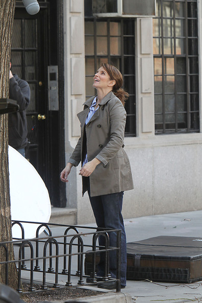 Tina Fey continues filming a scene, landing on a mattress and looking up at a building, while on the set of '30 Rock'. The funny woman was seen filming earlier from a window sill, with the camera rolling right outside.