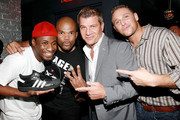 Chef Chris Nirschel, Tom Murro, DMC of RunDMC and Eric Kelly (Olympic Boxer) pose for pictures at a birthday party in New York.