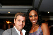 Tennis Star Venus Williams and Tom Murro poses for photographs at the Hamptons Magazine cover party in New York .