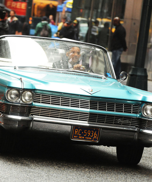 "Will Smith films a scene for his upcoming film ""Men in Black III"" in a classic, Cadillac convertible."