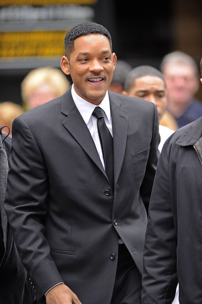 "Will Smith once again dons the classic black suit, black tie and white button up shirt as he walks to the set of the highly anticipated ""Men in Black III"". Smith looked excited to get to work on the third installment of the popular series, as he posed for photographs while still on the move."