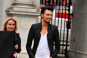 'X Factor' finalist and 'Big Brother's Bit On The Side' presenter Rylan Clark poses for his new anti-fur PETA advertisement, with Meg Matthews, in which he appears naked next to the words 'Fur-Free and Proud' outside the Marble Arch in London.