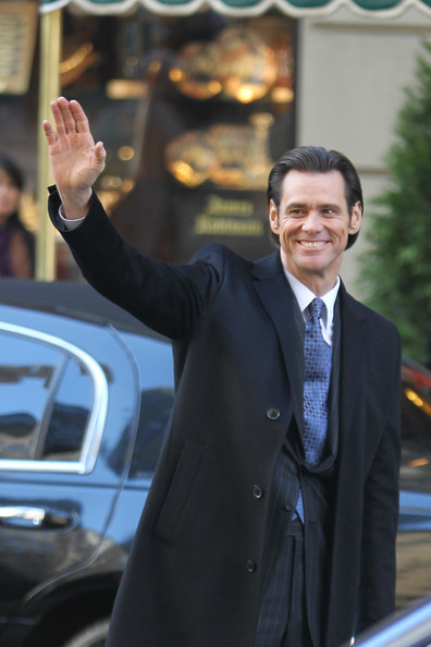 "A dapper looking Jim Carey waves to fans as he continues filming scenes on the set of ""Mr Popper's Penguin"" in NYC. The film, set to be released next year, circles around the life of a businessman who inherits six penguins."