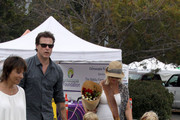 A pregnant Tori Spelling and her husband Dean McDermott go shopping at the Malibu Farmers Market before taking kids Liam and Stella to the park. Tori and Dean could be seen snacking on treats at the market before they took pictures of their children playing on the sculptures in the park.