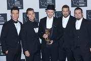 JC Chasez, Lance Bass, Justin Timberlake, Joey Fatone and Chris Kirkpatrick of N'Sync attend press room of the 2013 MTV Video Music Awards at the Barclays Center in the Brooklyn borough of New York City.