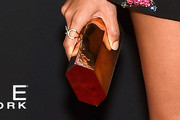 Joan Smalls Metallic Clutch