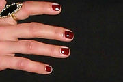 Natasha Henstridge Red Nail Polish