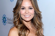 Brooke Burke-Charvet Feathered Flip
