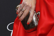 Claudia Schiffer Metallic Clutch